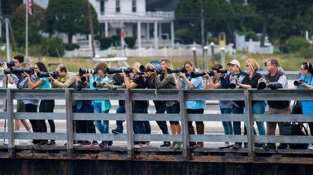 Photographers on alert at the Mill Dam Bridge
