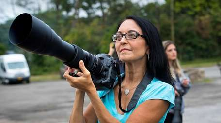 Christine Carrion-Alfano of Northport with her camera at