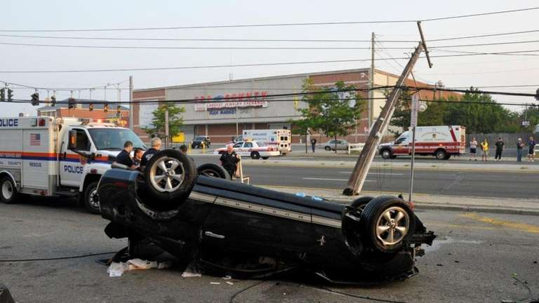 Overturned car closes eastbound Hempstead Turnpike in