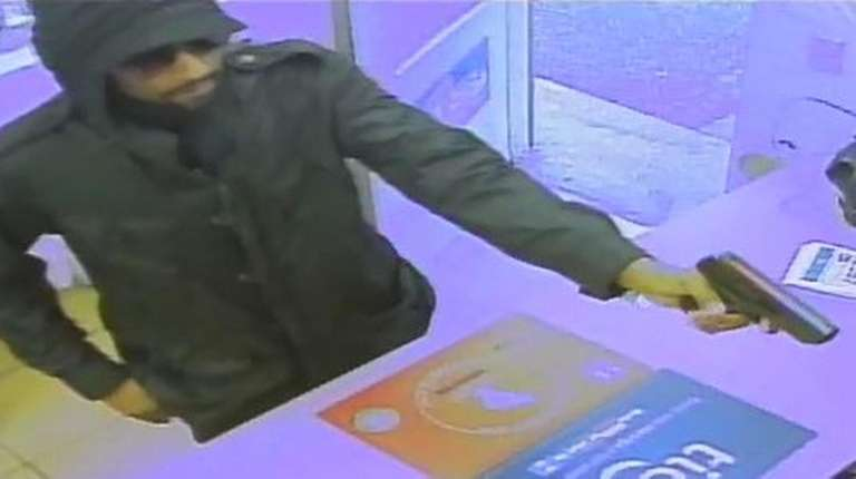 This surveillance video image shows a man displaying