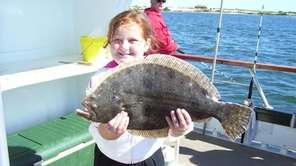 Children enjoy fishing off the Island Princess out