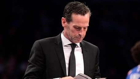 Head coach Kenny Atkinson of the Nets checks