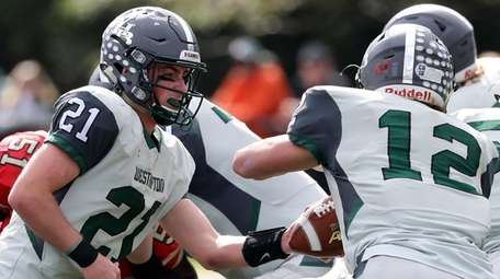 Westhampton's quaterback Clarke Lewis (21) hands off to
