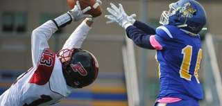 Donovan Pepe of Plainedge intercepts a pass intended