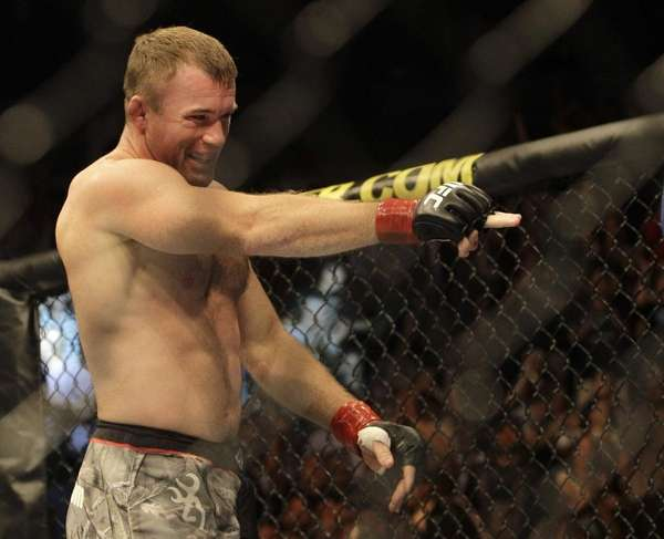 Matt Hughes celebrates after submitting Ricardo Almeida in