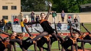 Hicksville High School's Starlets kickline squad perform during