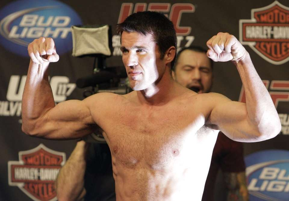 Chael Sonnen flexes after weighing in at a