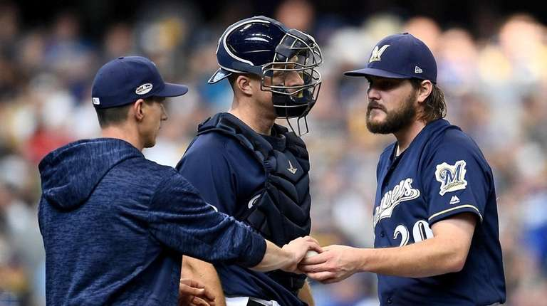 Wade Miley of the Brewers is pulled by