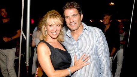 Ramona Singer with husband, Mario. She is wearing