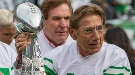 Joe Namath holds the Super Bowl trophy during