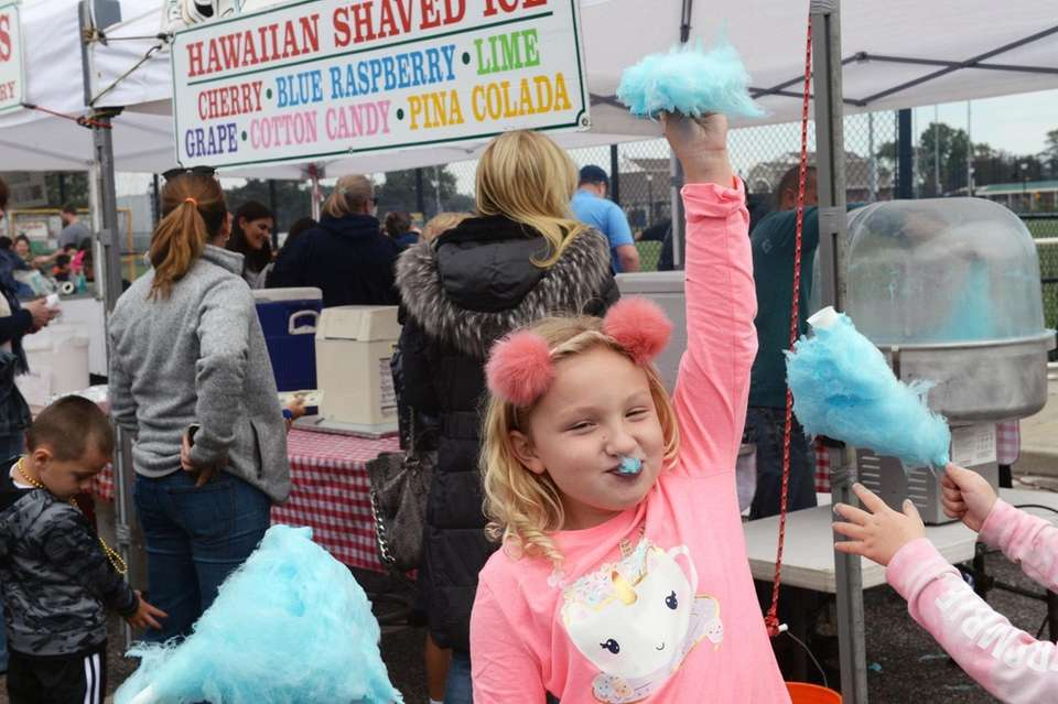 Madison Anderson, 7, from Bellmore, eats blue raspberry