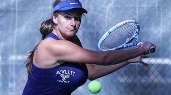 Rachel Arbitman of Hewlett goes to her backhand