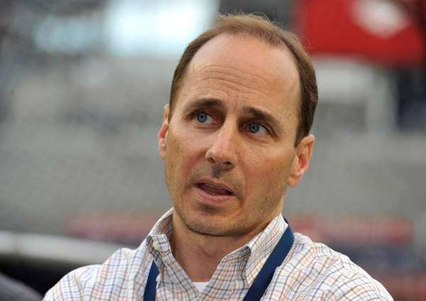 Yankees general manager Brian Cashman talks to reporters