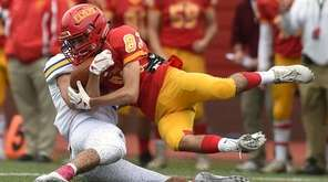 Paolo Maggio #83 of Chaminade gets tackled by