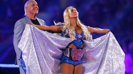 Charlotte Flair, shown with her father, Ric, in