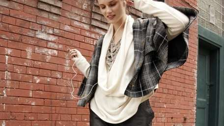 Joie black-and-ivory plaid cape at $398 will be