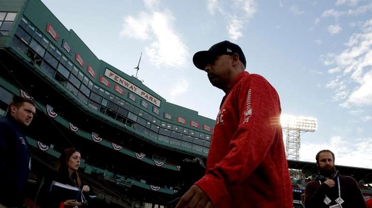 Red Sox manager Alex Cora walks to the