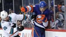 Anthony Beauvillier #18 of the Islanders is checked