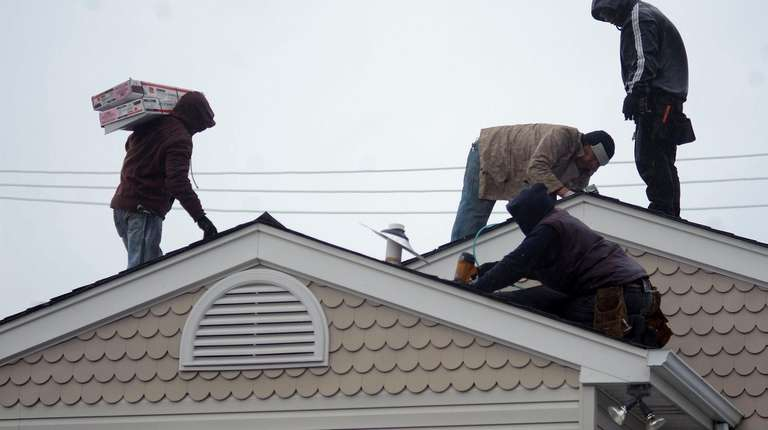 A roof being installed on a house in