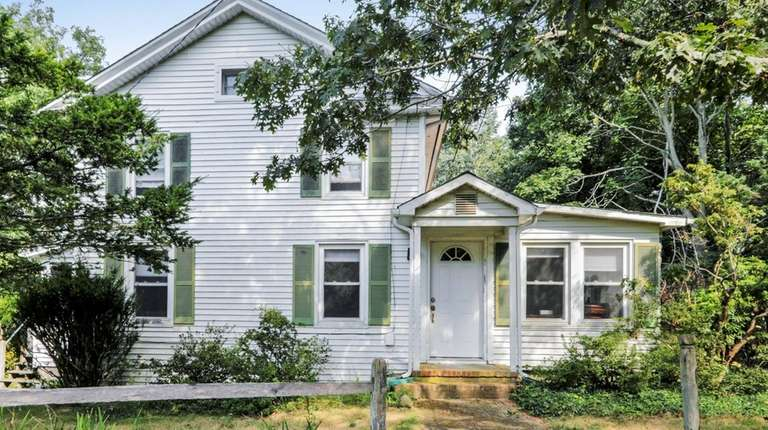 This Southold property, built in 1837, has three