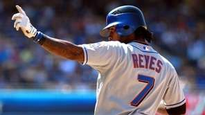 Jose Reyes gestures towards the dugout after hitting