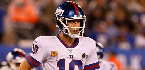 Eli Manning of the Giants looks on during