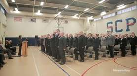 Suffolk County officials swore in 119 recruits during a