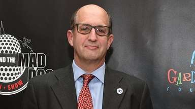 Former Knicks head coach Jeff Van Gundy walks
