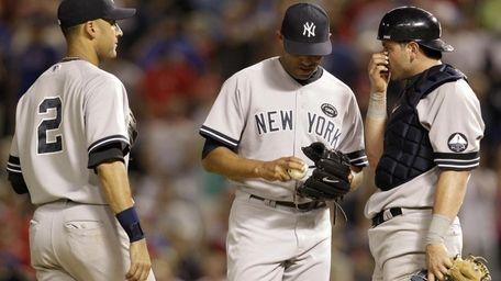Yankees shortstop Derek Jeter (2) and catcher Francisco