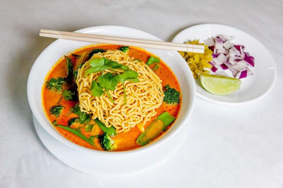 Tofu kao-soy, featuring both boiled and fried noodles,