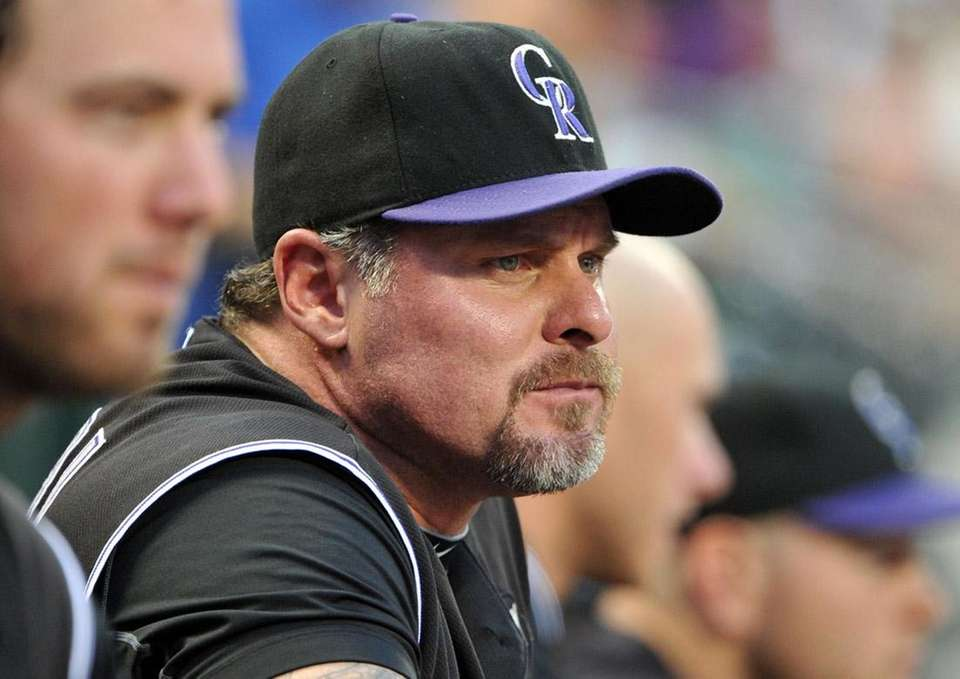 Colorado's Jason Giambi in the dugout at Citi
