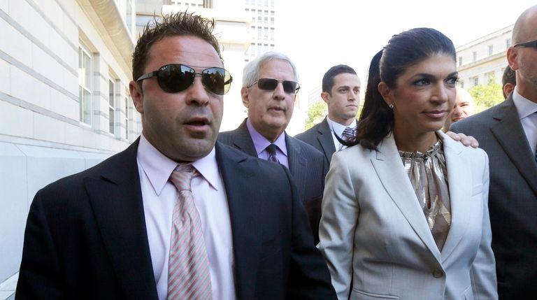 Joe Giudice and his wife, Teresa Giudice, leave