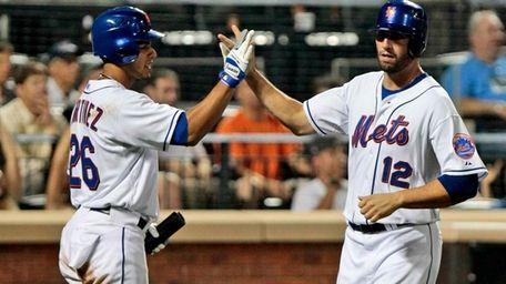 The Mets' Jeff Francoeur (12) celebrates with Fernando