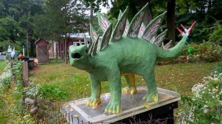 This dinosaur and other statues are found on