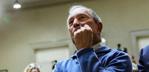Former New York City Mayor Michael Bloomberg listens