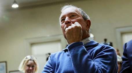 Former New York City Mayor Michael Bloomberg listens