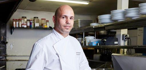 Chef Alex Bujoreanu, here in the kitchen of