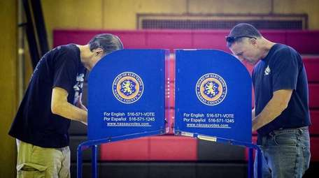 Voters fill in their paper ballots at Wisdom