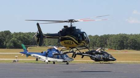 Helicopters at East Hampton Airport in August 2014.