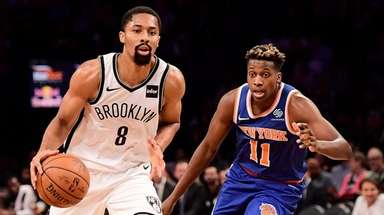 The Nets' Spencer Dinwiddie is defended by the