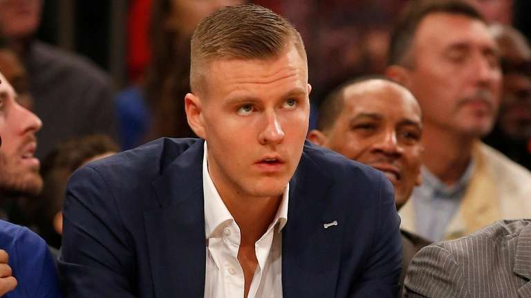 Knicks forward Kristaps Porzingis looks on from the