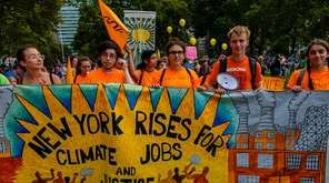 Demonstrators attend the Rise for Climate, Jobs, and
