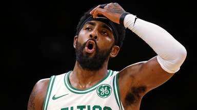 Celtics guard Kyrie Irving reacts during the first