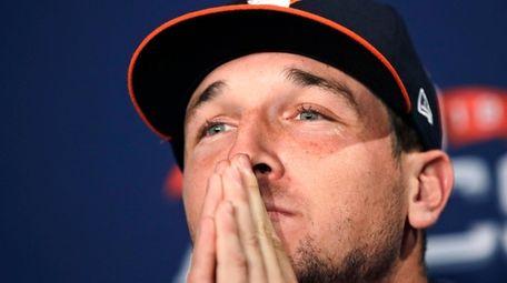 Astros third baseman Alex Bregman listens to a