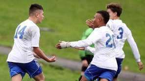 North Babylon's Erick Radtke (14) is contgratulated by