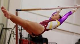 Bayshore/Islip's Catherine Lyden performs on the uneven bars