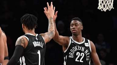 Caris LeVert high-fives D'Angelo Russell against the Memphis