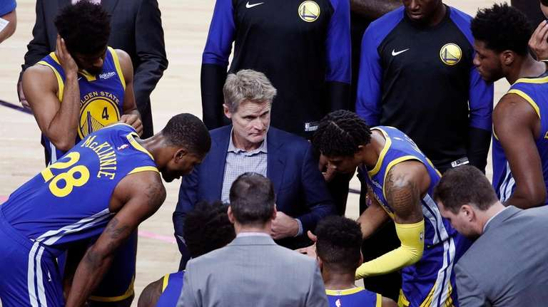 Warriors coach Steve Kerr talks to his players