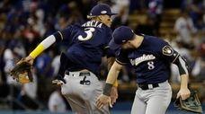 The Brewers' Orlando Arcia and Ryan Braun celebrate