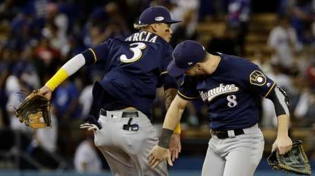 The Brewers' Orlando Arcia and Ryan Braun celebrate